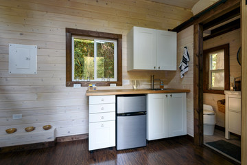 Interior design of a kitchen in a tiny rustic log cabin.
