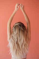 Anonymous blonde woman with arms up
