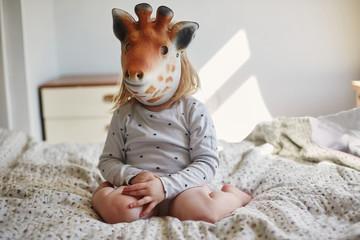 Little girl wearing a Giraffe mask