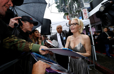 Actor Anderson signs autographs after unveiling her star on the Hollywood Walk of Fame in Los Angeles