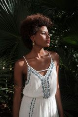 Portrait Of Beautiful African Woman Wearing White Dress
