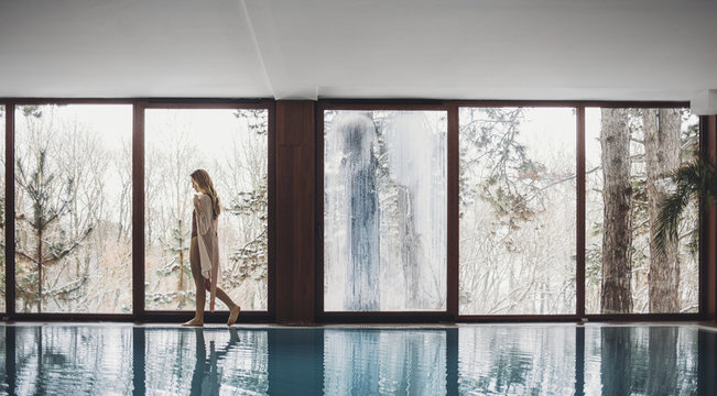 Woman walking by swimming pool