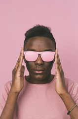 Portrait of young man with pink eyeglasses and t shirt