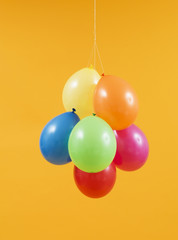 Colorful balloons in orange background