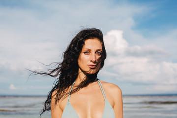 Beautiful blue eyes woman on the beach