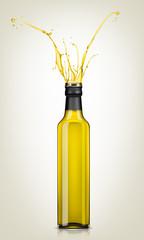 splash olive oil from glass bottle