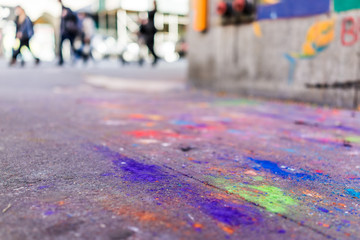 Macro closeup of colorful chalk art on ground with purple, blue and green colors on asphalt street sidewalk in urban New York City, Manhattan