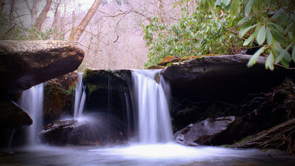 Wide Screen Photo of Waterfall in the Woods Slow Shutter Speed Motion Blurred
