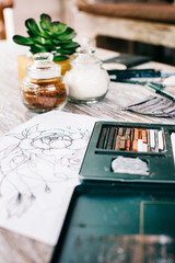 Closeup of Art Supplies on Shabby Chic Wooden Table