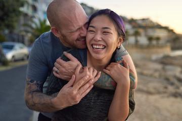 Multi-racial couple laughing having fun