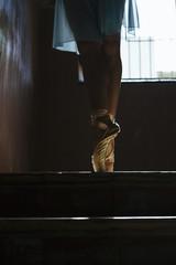 detail of a ballet dancer feet in a warehouse