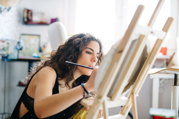 Female artist in process of painting