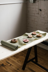 donuts on top of unrolled green paper