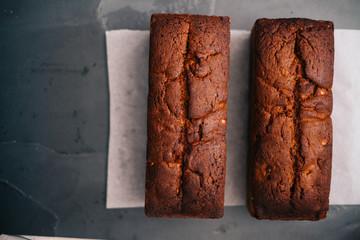 Banana bread loaf; Homemade banana bread on dark stone background.