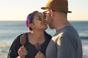 Cute mixed race couple on a date having ice-cream