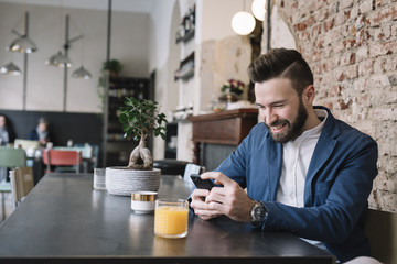 Man surfing phone having a juice