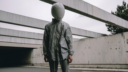 Abstract scene with person with white helmet/mask and silver jacket