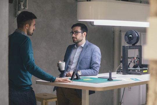 Businessmen Chatting at Work