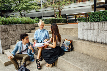 Three College Students Talking on Campus