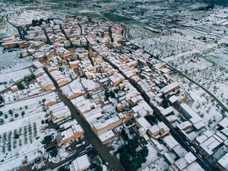 Aerial view of village with snow