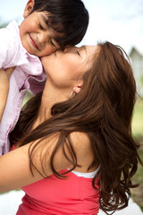 Young Hispanic mother and her son.
