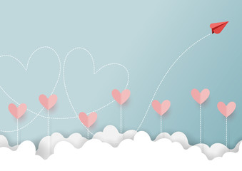 Paper art style of valentine's day greeting card and love concept.Red paper airplane flying look like couple of heart shape on clouds and blue sky.Vector illustration.