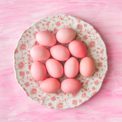 Pink Easter eggs on pink background