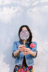 Female person holding lollipop