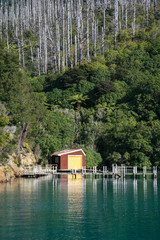 Small colourful boat shed