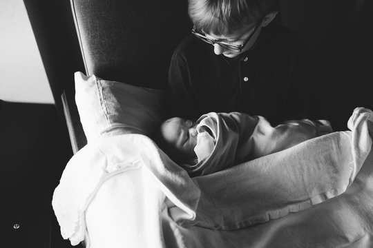 big brother meeting his baby brother for the first time in the hospital