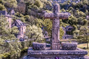 Cross on bridge over the river Aveyron France