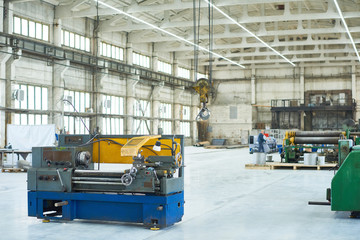 Wide angle shot of  spacious light workshop at modern factory,  industrial background with copy space