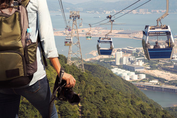 Nature photography  with digital camera on top of the mountain with cable car at the Lantau Island in Hong Kong. professional Nature photographer and the mountain