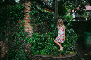 Young girl exploring lush Bali town