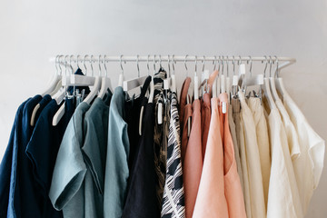 clothing rack filled with colorful fabrics and clothing