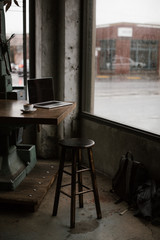 laptop on table in coffee shop with industrial feel