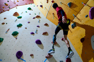Disabled athlete doing climbing