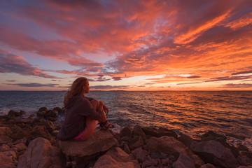 Woman admiring the seascape during sunrise