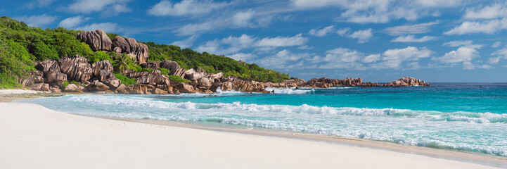 White sand and granite rocks on tropical beach in Seychelles.
