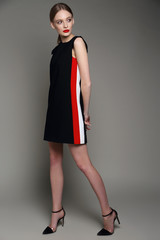 high fashion woman in short black dress.