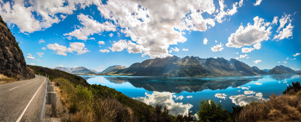 180 degrees Viewpoint Panorama overlooking Lake Wakatipu at Bennett's Bluff Lookout at golden hour, one of the most the scenic drives in New Zealand