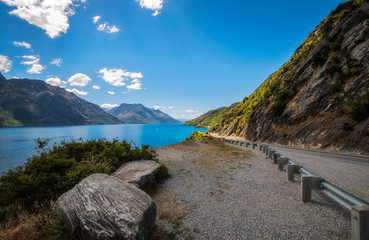 The winding road along the shore of Lake Wakatipu at Devil Staircase scenic lookout, not far from Queenstown, in the Southern Island of New Zealand.