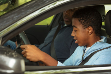 Father teaching his son how to drive. Wall mural