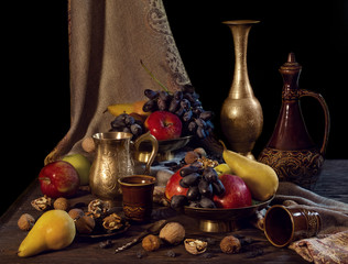 Still life with fruits in vases.