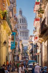 Havana, Cuba, El Capitolio seen from a narrow street