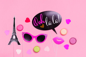 French theme photo props - lips, mustaches, gift box and macaroons on pink Valentines day background