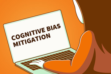 Woman looking at a laptop screen with the words cognitive bias mitigation