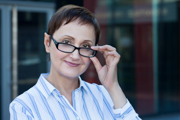 Business woman portrait. Professional headshot of middle aged older woman 40 50 years old wearing glasses.