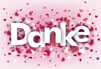 Das Wort Danke mit Herzen auf rosa Hintergrund