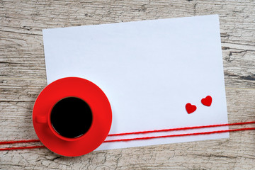 valentine's day background, red coffee cup and heart shapes on white wooden planks
